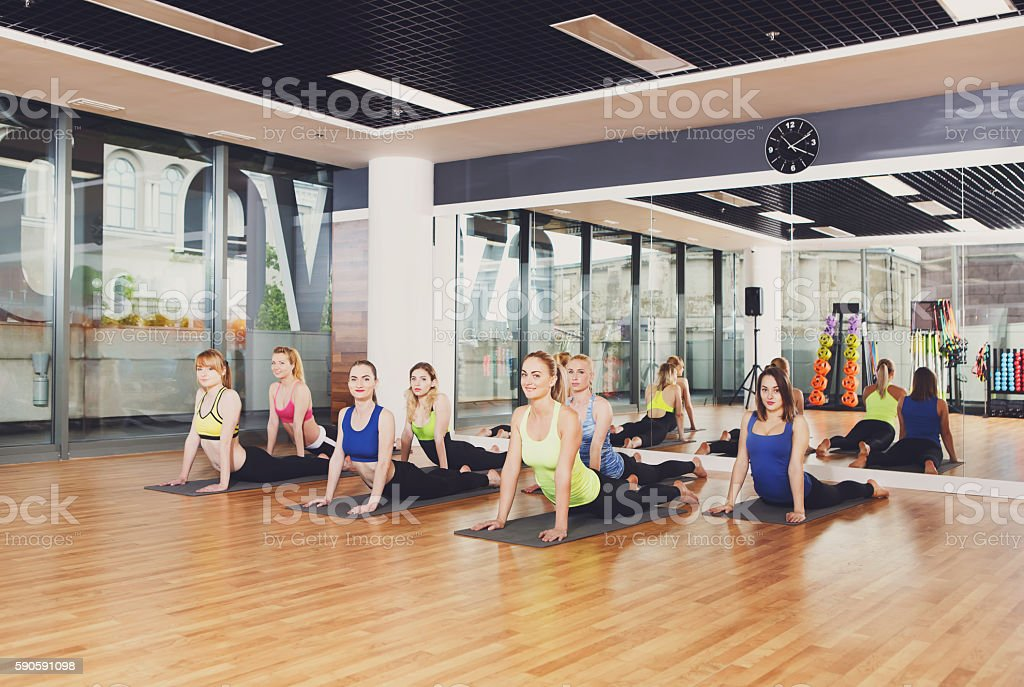 Group of young women in yoga class stock photo