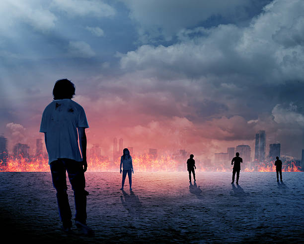 group of zombie over burn city background - apocalypse stock photos and pictures