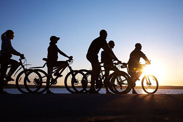 group on bicycles  female biker resting stock pictures, royalty-free photos & images