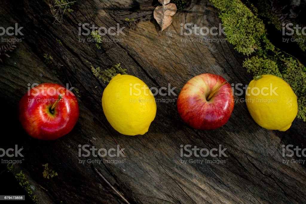 A Group or Row of Fresh Fruits on Wooden Background. Apple, Orange, Pear, Lemon and Orange 免版稅 stock photo