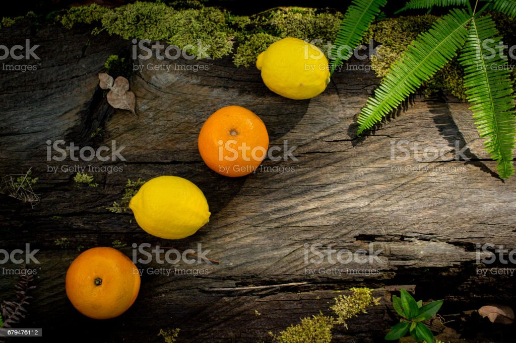 A Group or Row of Fresh Fruits on Wooden Background. Apple, Orange, Pear, Lemon and Orange royalty-free stock photo