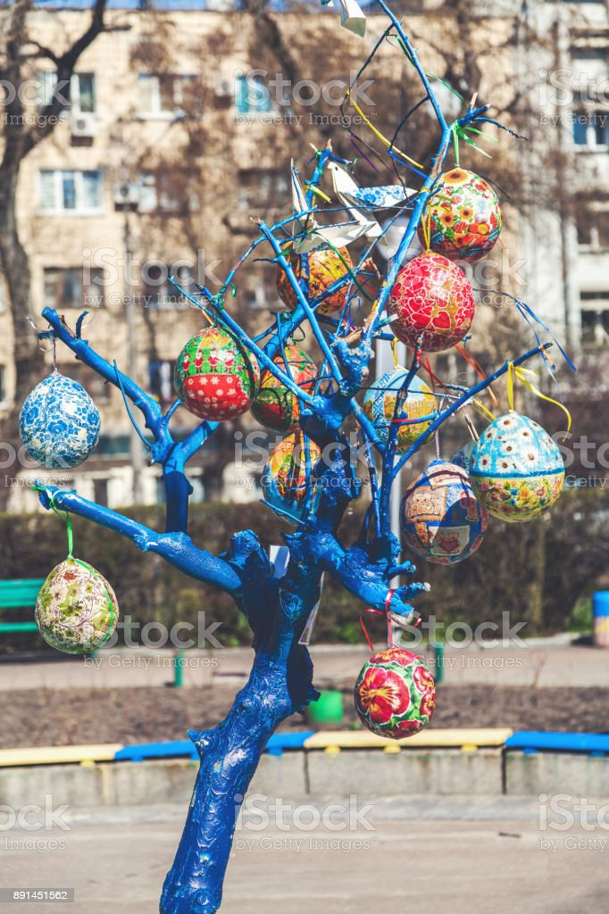 Group painted Easter eggs on tree branch stock photo