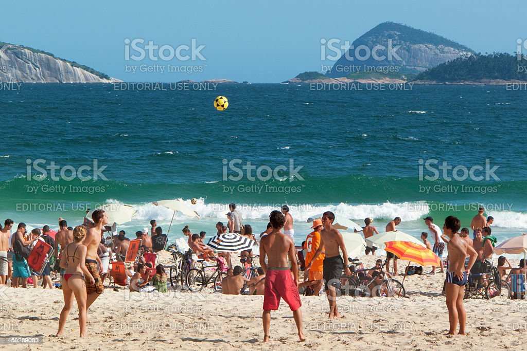 Group plays soccer in Ipanema Beach royalty-free stock photo