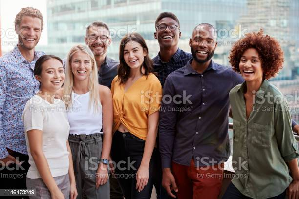 Group Portrait Of A Creative Business Team Standing Outdoors Three Quarter Length Close Up Stock Photo - Download Image Now