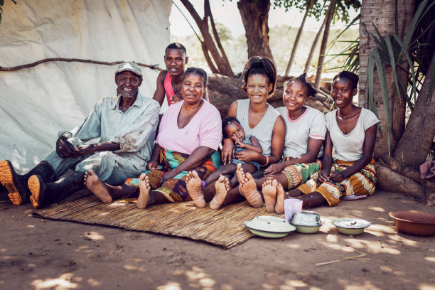 Group Portrait of a Multi Generation African Village Family stock photo