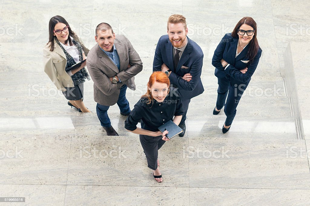 Group portrait of business people in the lobby stock photo