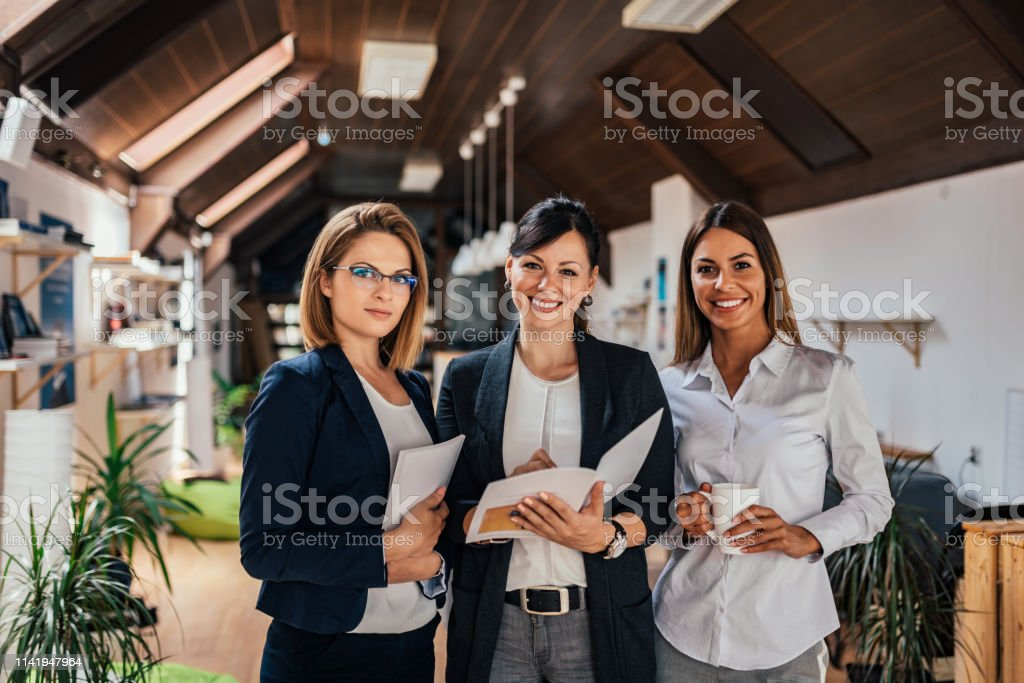 Group portrait of confident female business team. Group portrait of confident female business team. Adult Stock Photo