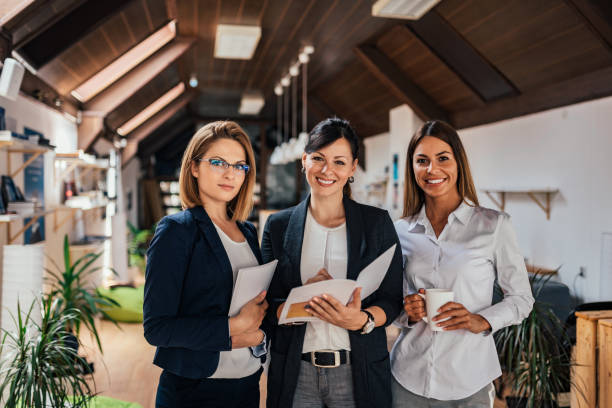 group portrait of confident female business team. - business woman foto e immagini stock