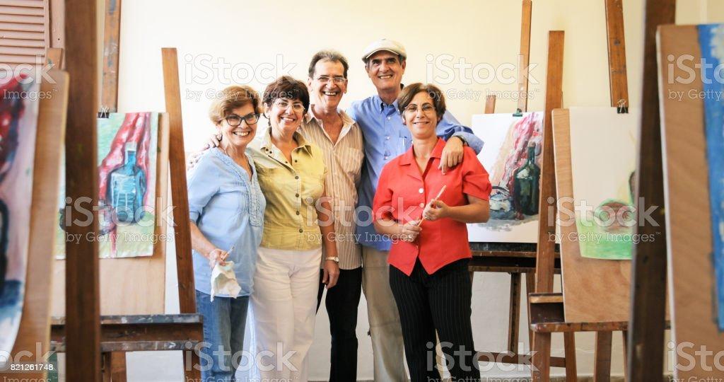 Group Portrait Of Elderly People Smiling At Art School stock photo