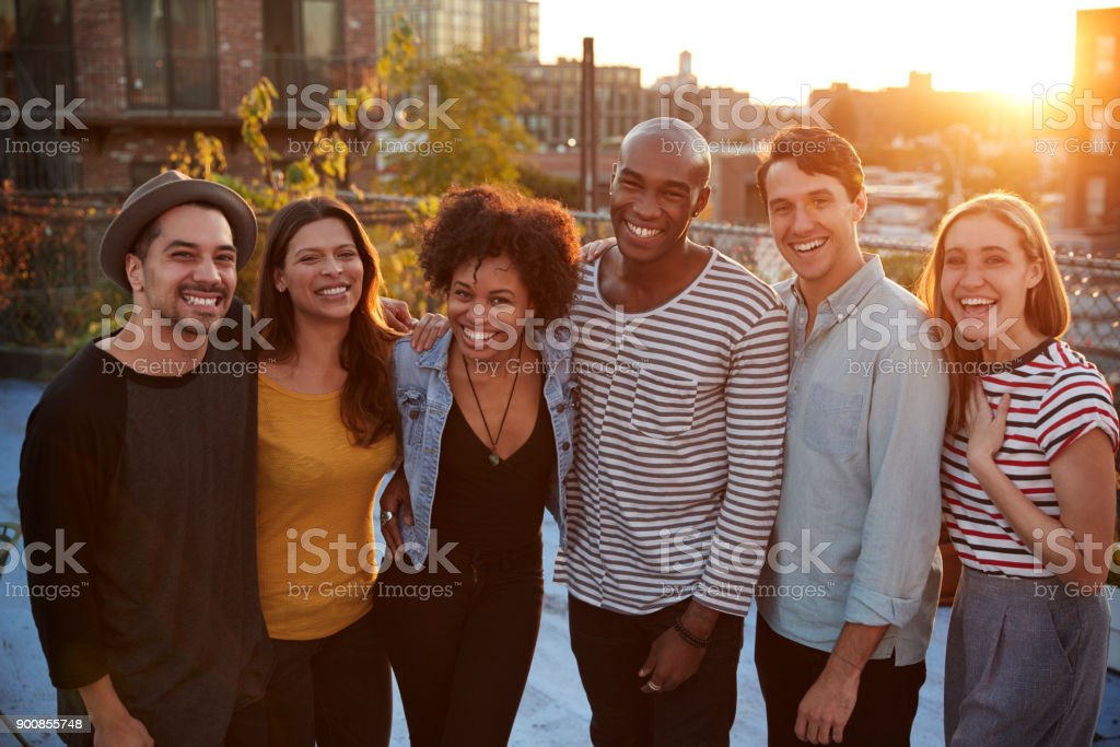 Group portrait of friends at a rooftop party in Brooklyn stock photo