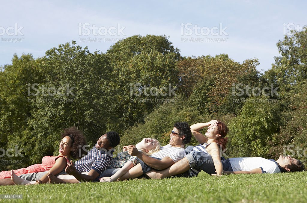 Group portrait of friends having fun outdoors royaltyfri bildbanksbilder