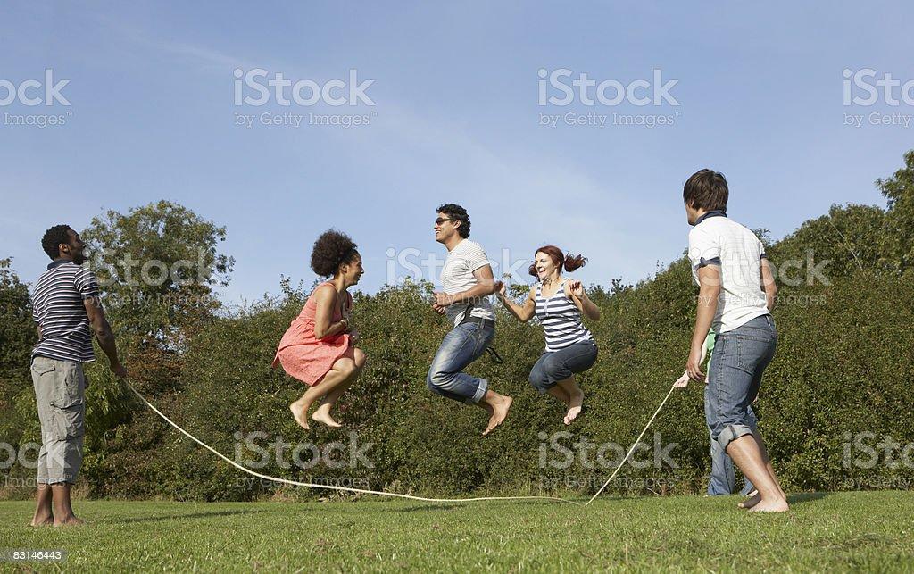 Group portrait of friends skipping zbiór zdjęć royalty-free