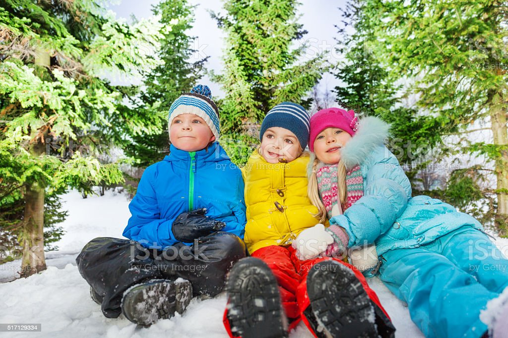 Group portrait of many kids together in snow stock photo