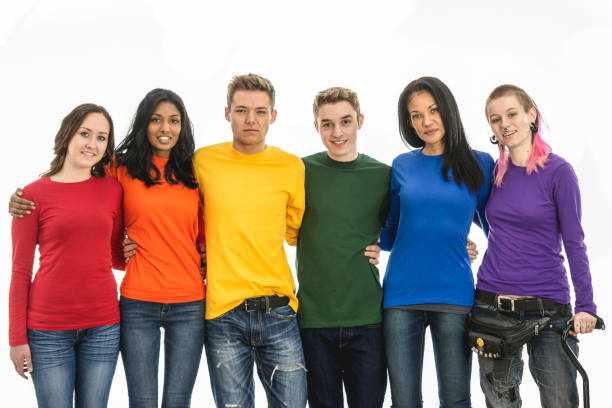 Group pose together to form the Pride flag A diverse group of people pose together in brightly coloured sweaters, to form a human gay Pride flag. cisgender stock pictures, royalty-free photos & images