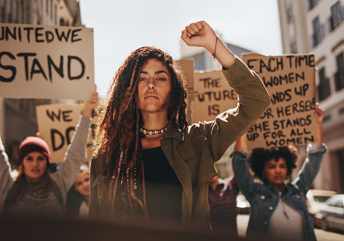 istock Group protesting for equality and women empowerment 1090929912