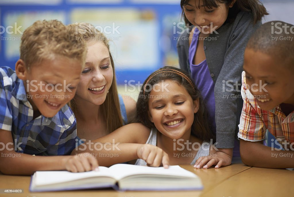 Group reading in english class stock photo