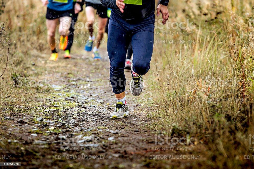 group runners running uphill stock photo