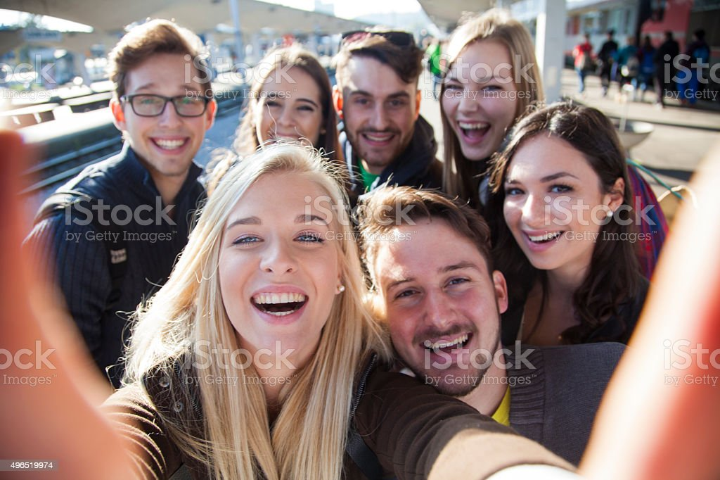 Group selfie of young people traveling stock photo