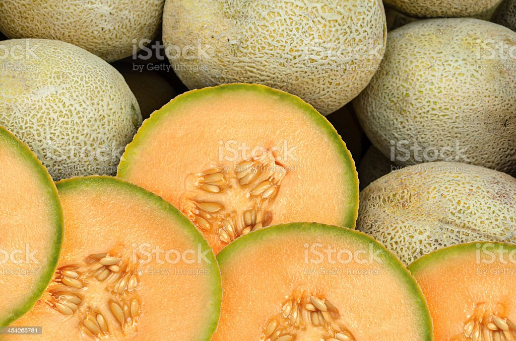 A group shoot of sliced cantaloupe melons stock photo