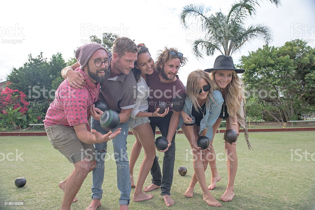 Group shot of bowlers playing barefoot stock photo