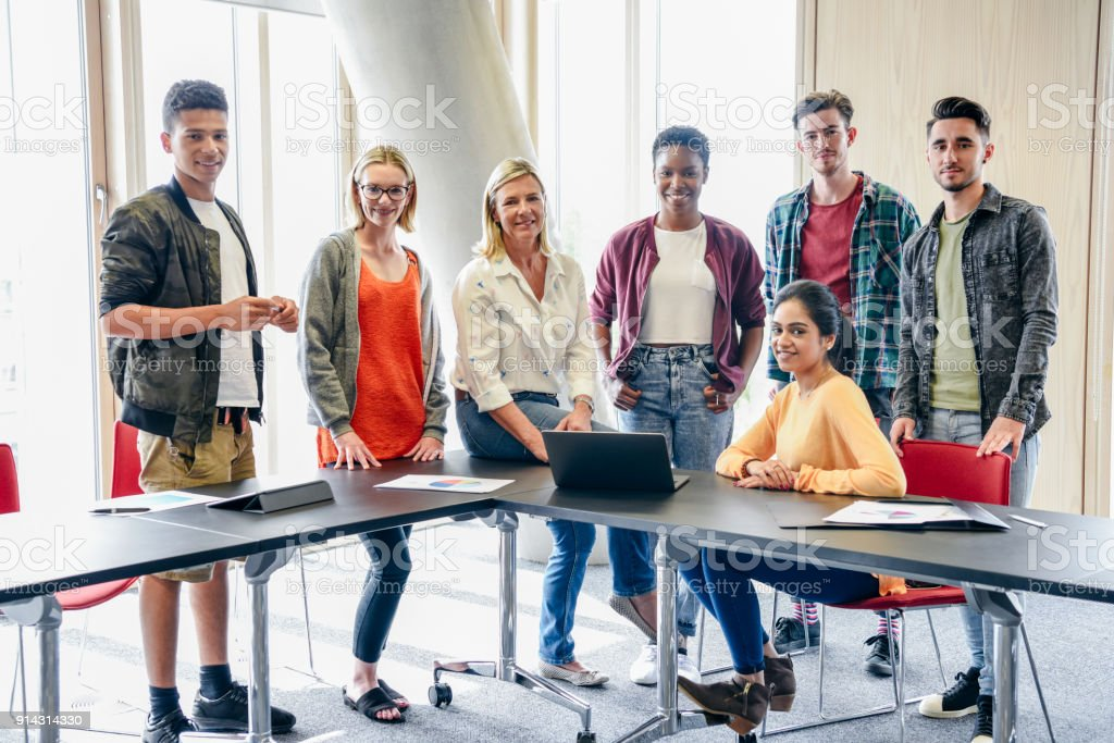 Group Shot Of Of College Students And Lecturer Laptop On Table Stock Photo Download Image Now Istock