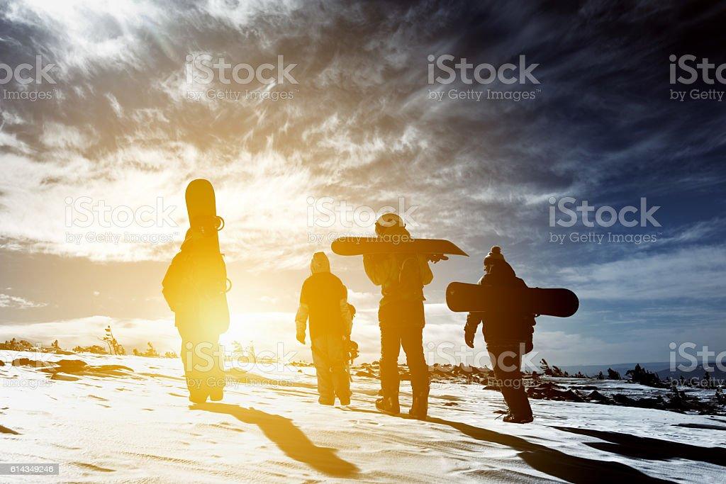 Group snowboarders snowboarding skiing concept - foto de stock