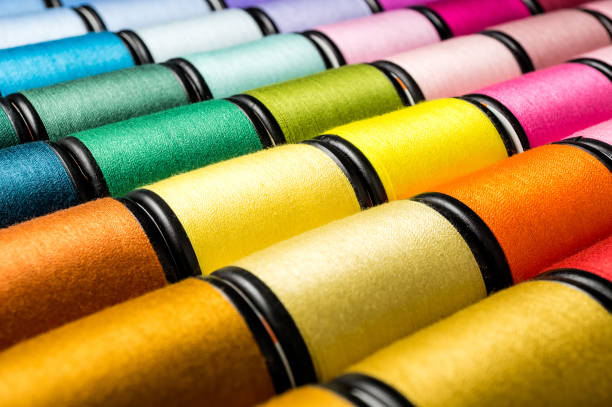 group spool of sewing threads - embroidery machine stock pictures, royalty-free photos & images