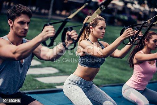 904150892 istock photo Group suspension training 904150848