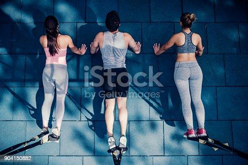 904150892 istock photo Group suspension training 904150882