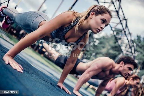 904150892 istock photo Group suspension training 904150886