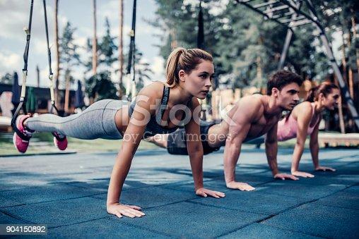 istock Group suspension training 904150892