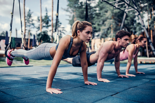 istock Group suspension training 904150892