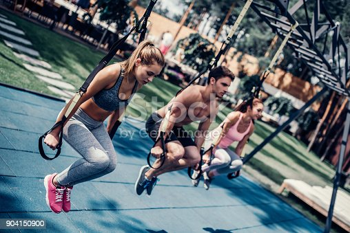 904150892 istock photo Group suspension training 904150900
