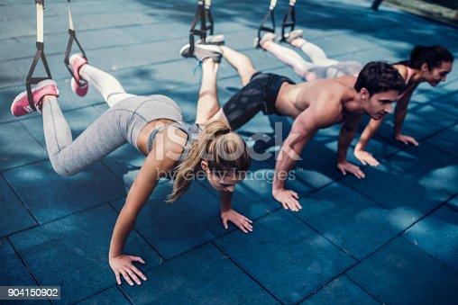 904150892 istock photo Group suspension training 904150902