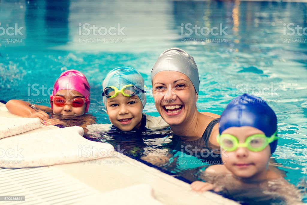Group swimming lesson for children stock photo