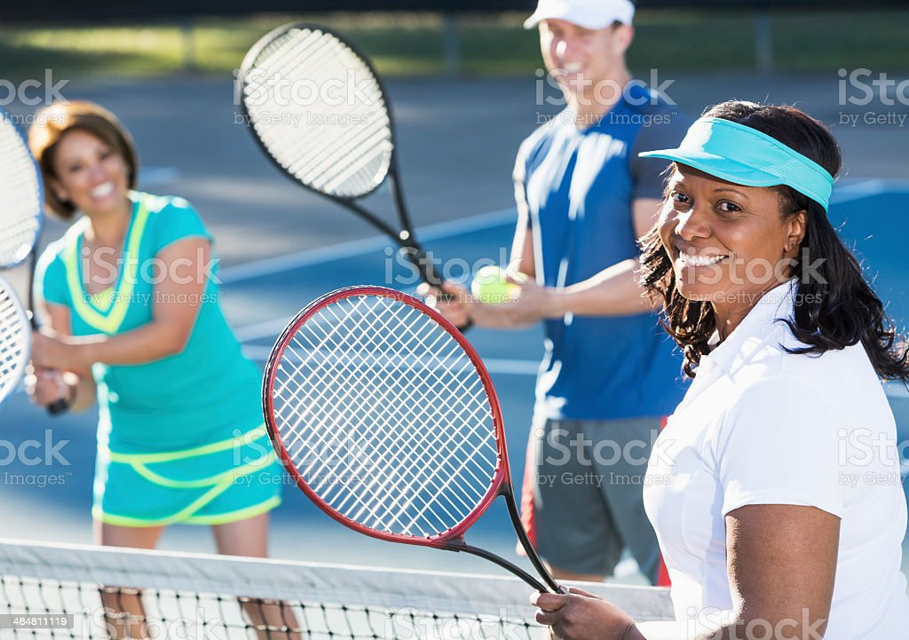 Group tennis lesson stock photo