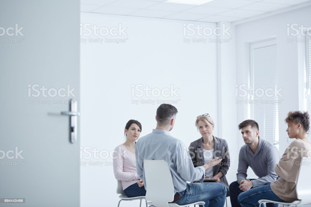Group therapy for PTSD stock photo
