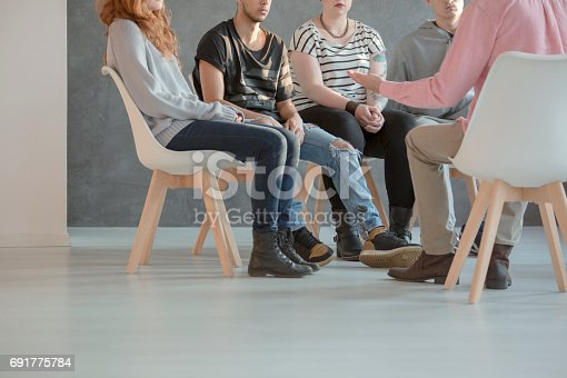 618070568 istock photo Group therapy for teenagers 691775784