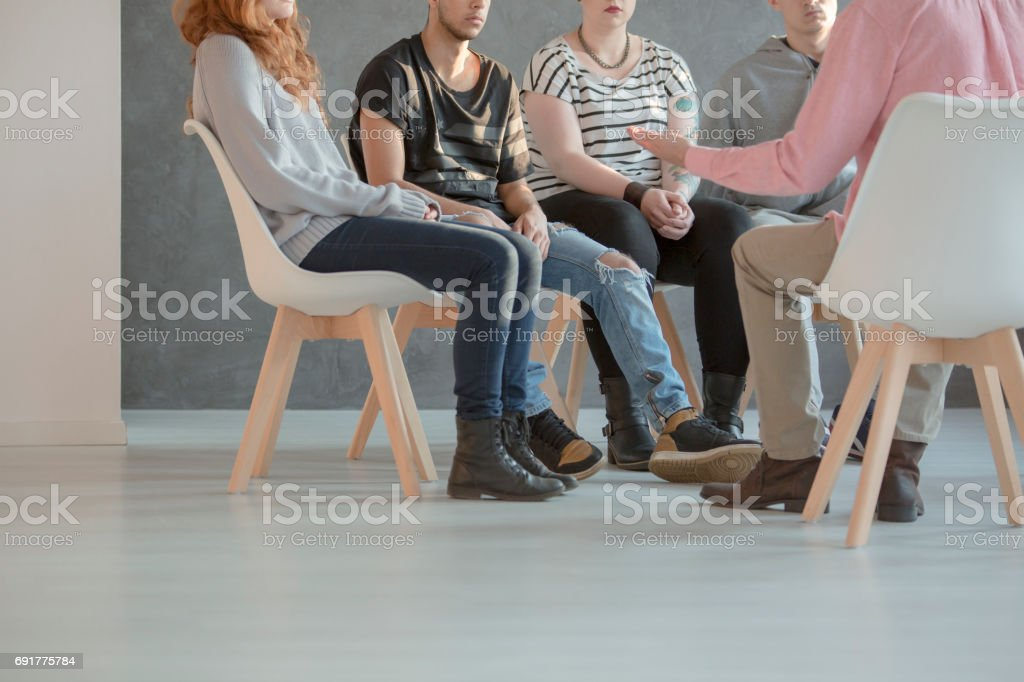 Group therapy for teenagers stock photo