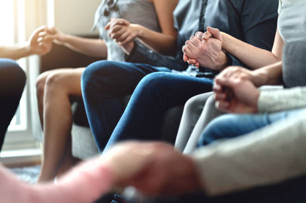 Group therapy, peer support and psychology session. Trust, unity and empathy concept. Empowering community. Hope, help and friendship. Team empowerment. stock photo