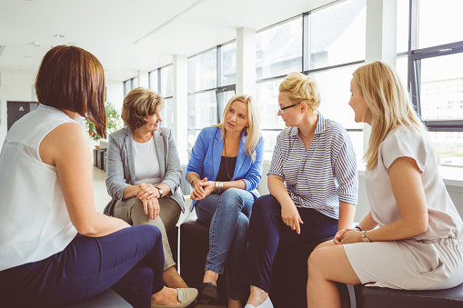 Group Therapy Session Of Women Stock Photo - Download Image Now