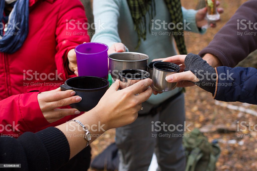 Group tourists girls on the nature drinking warming drink. Celebration stock photo