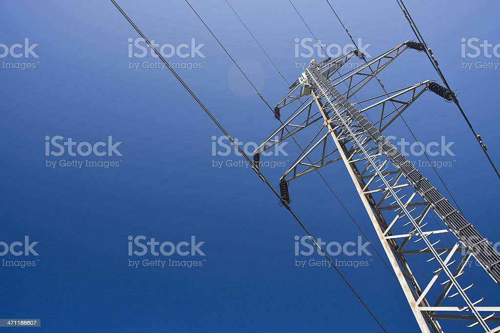A group view of an electric tower Electricity pylon on a clear blue sky. Blue Stock Photo