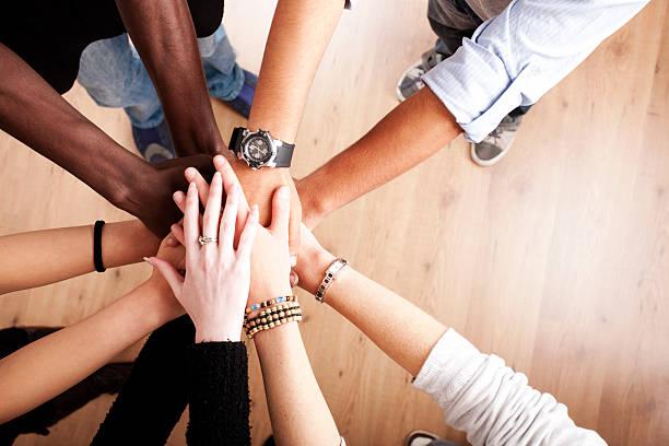 group with hands together - stötta beskrivande position bildbanksfoton och bilder
