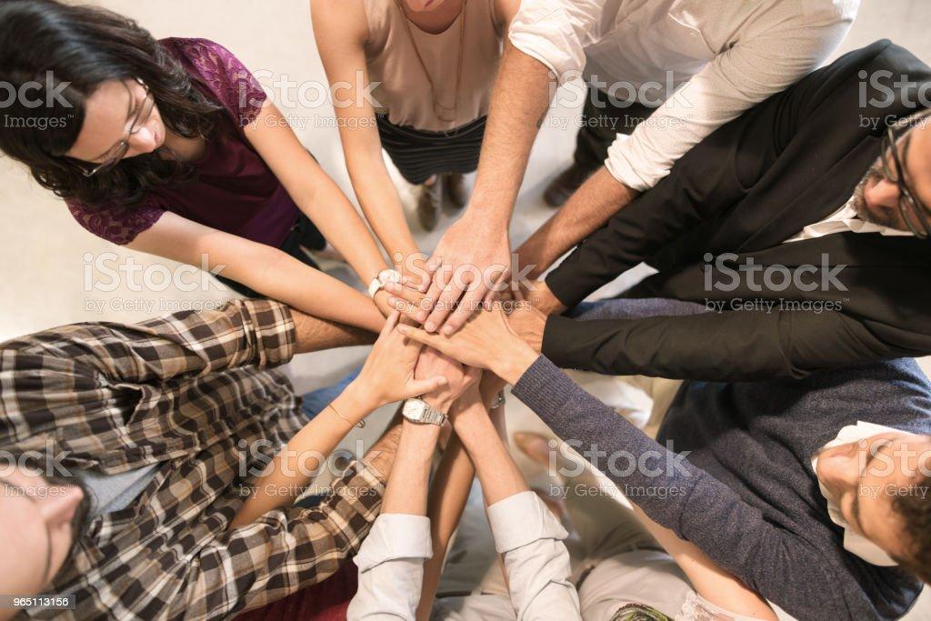 Group with hands together zbiór zdjęć royalty-free