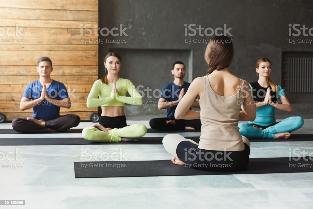Group with yoga instructor in fitness club royalty-free stock photo