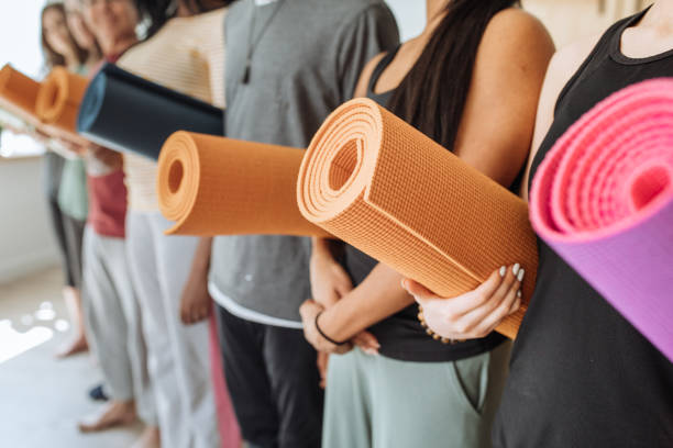 Group with yoga mats stock photo