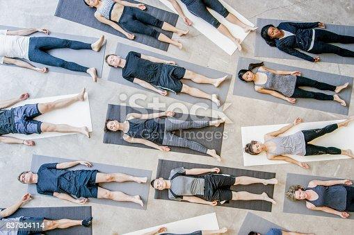 637804152istockphoto Group yoga 637804114