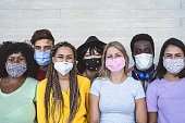 Group young people wearing face mask for preventing corona virus outbreak - Millennial friends with different age and culture portrait -  Coronavirus disease and youth multi ethnic concept