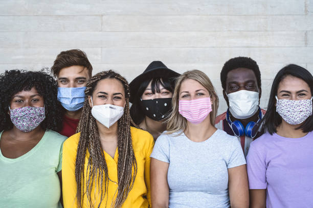 Group young people wearing face mask for preventing corona virus outbreak - Millennial friends with different age and culture portrait -  Coronavirus disease and youth multi ethnic concept Group young people wearing face mask for preventing corona virus outbreak - Millennial friends with different age and culture portrait -  Coronavirus disease and youth multi ethnic concept multi ethnic group stock pictures, royalty-free photos & images
